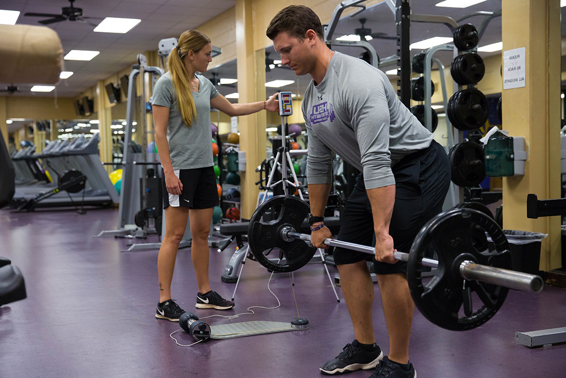 HSU student doing dead lift weights at the campus gym